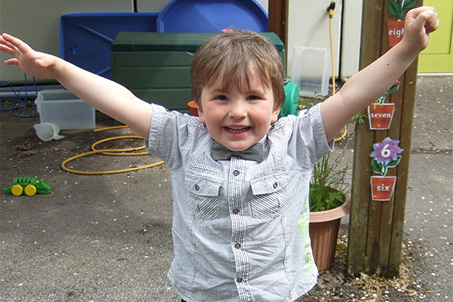 Young Boy Joyous At Success In Science