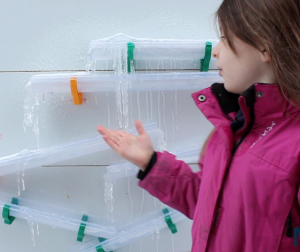 A young girl showing how she made icicles using moti-lab