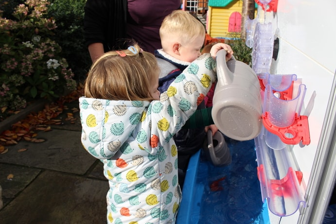 An EYFS girlg and boy using multi sensory learning on Moti-Lab