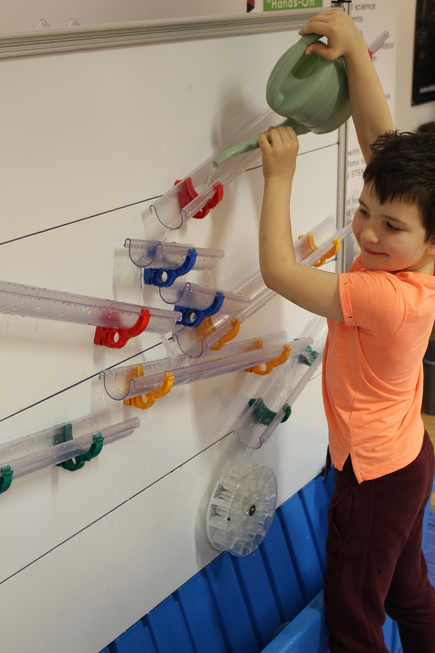 A boy exploring practical maths and science on moti-lab